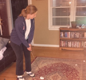 It's a humble beginning, but at least The Wife is being diligent in practicing her putting stroke.