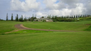 From the 9th green, the otherwise posh Plantation Course Clubhouse  somehow fails to live up to the amazing visuals of the mountains, ocean, and islands.