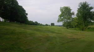 The view of the relatively gentle par 5 1st hole from the end of the first fairway.  One of many holes that a smarter golfer won't hit driver on the tee at Lassing Pointe.