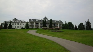 The massive Persimmon Ridge clubhouse awaits atop the hill leading away from the 18th green.