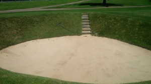 I was warned to avoid the deep, green-side bunker on No. 12.  Two sandblasts later, I'd learned my lesson.