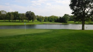 A look at the 17th green, with the imposing pond and 16th approach and green in the background.