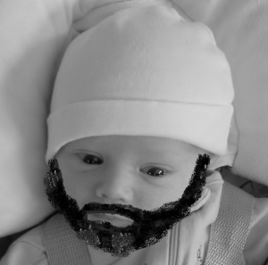 Here is our little man, The Bearded Baby, or Beebo, for short. The Wife reads him Shel Silverstein, I read him Harvey Penick.