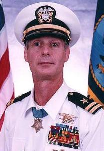 After a medical discharge from the Navy, Lt. Thomas R. Norris enjoyed a 20 year career with the FBI where he was an original member of the agency's first Hostage Rescue Team.