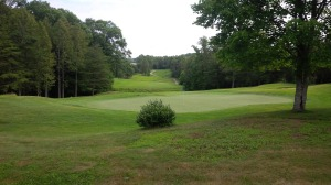 A look back at the 18th hole from behind the green at Hidden Cove.