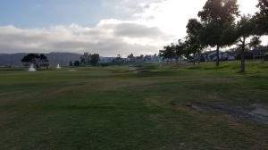 This is the view from the 18th tee, which provides little information or comfort to the golfer about to hit a shot.
